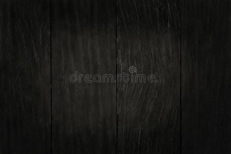 Black wooden wall background, texture of dark bark wood with old natural pattern for design art work, top view of grain timber.  royalty free stock photos
