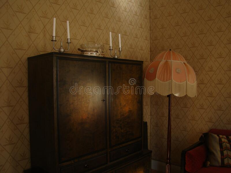 Black Wooden Wardrobe and White and Pink Pedestal Lamp Inside the Room royalty free stock photography