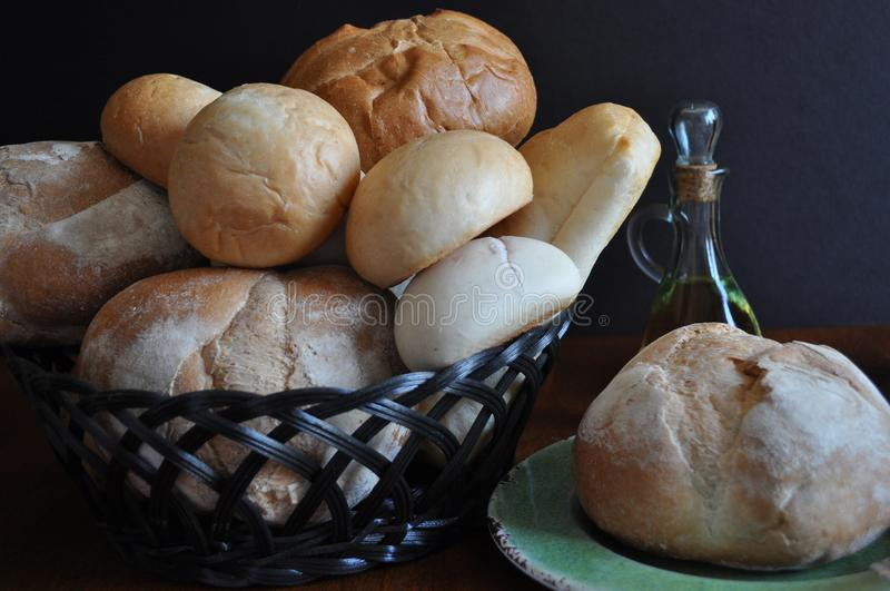 Variety of breads and rolls in a basket stock images