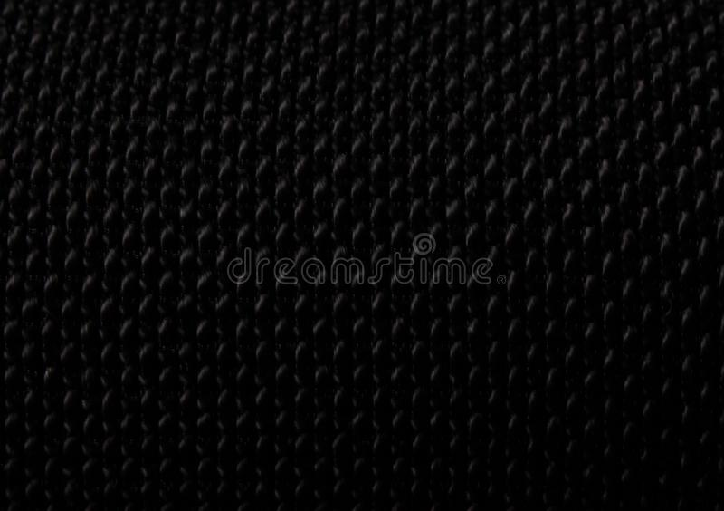 Black woven material textured background stock images