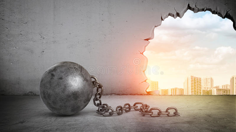 A black wrecking ball and hole in a concrete wall showing city landscape. stock images
