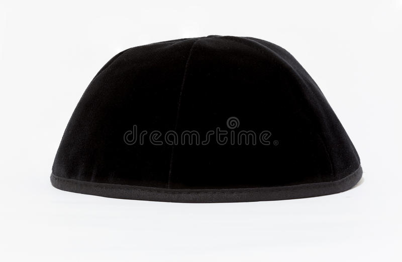Black yarmulke. Black kippa in Hebrew. With a white background royalty free stock photos