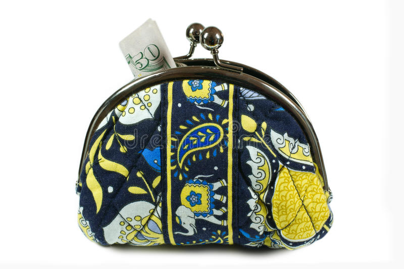 Black and Yellow Coin Purse with Money. Sticking out stock photography