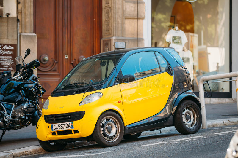black and yellow colors smart fortwo coupe on street in marseill