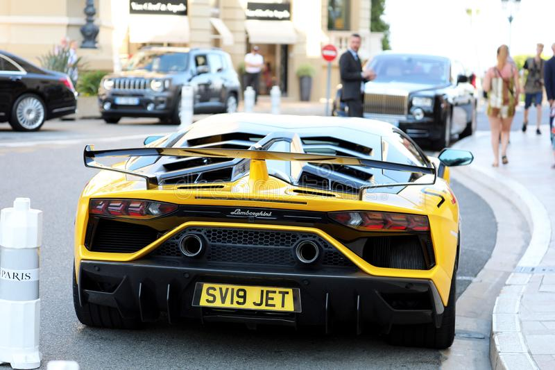 Black And Yellow Lamborghini SVJ - Rear View stock photos
