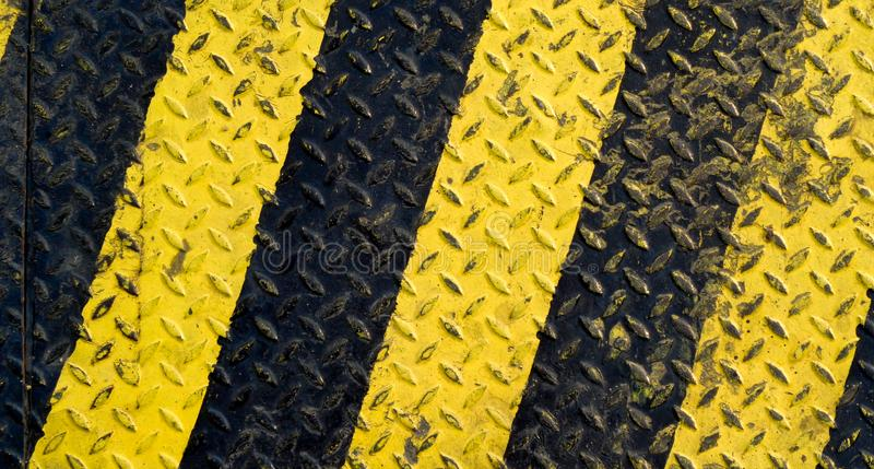 Black and yellow line paint on non-slip metal stock photos