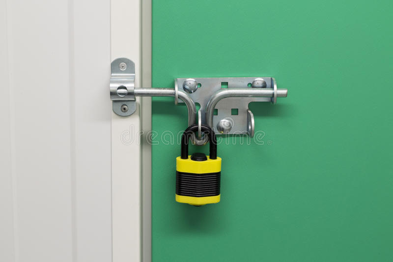 Download Black And Yellow Padlock On Self Storage Unit Stock Image - Image of security, padlock: 39505865