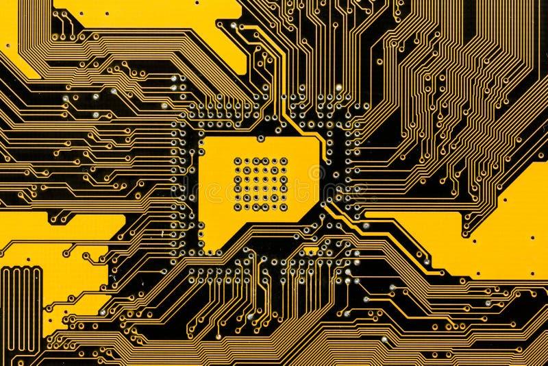 Black and yellow pcb circuit of motherboard. Macro shot stock illustration