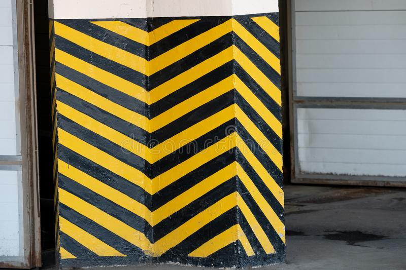 Black and yellow striped markings as a danger warning. Background, construction, grunge, industrial, pattern, sign, surface, symbol, texture, traffic, wall royalty free stock photo