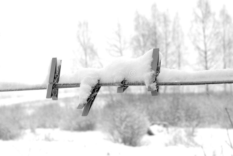 Linen pins. Blackandwhite linen pins covered by snow stock photos