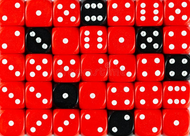 BlackBackground of random ordered red dices with six black cubes. Pattern background of random ordered red dices with six black cubes stock images