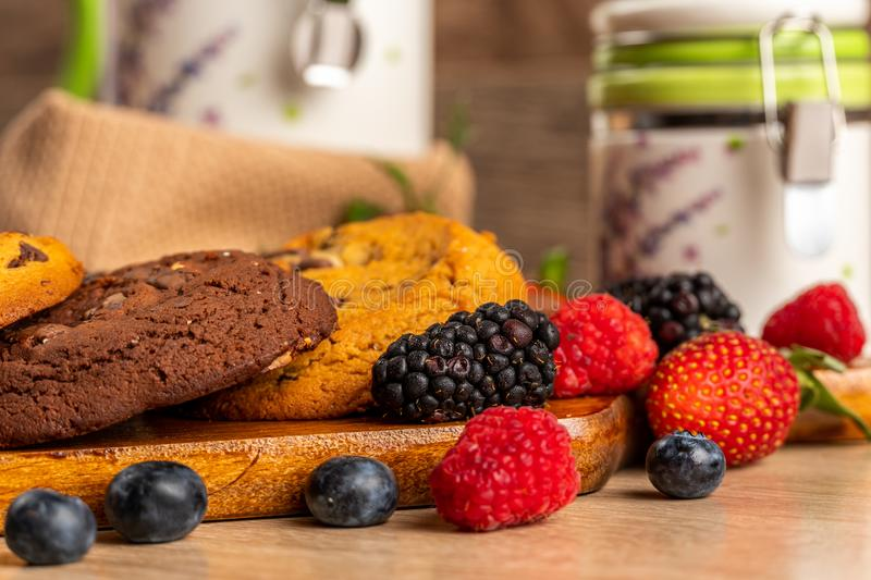 Blackberries, raspberries and chocolate scones close-up shot royalty free stock image