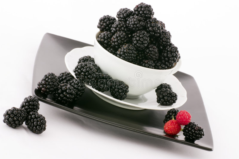 The blackberry. Macro view of fresh ripe blackberries in the bowl stock photography
