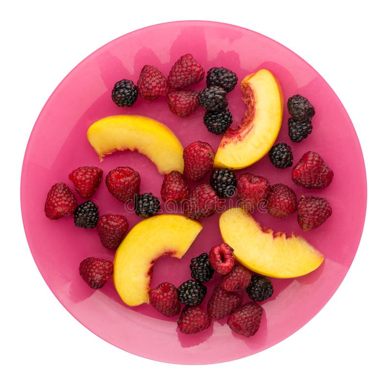 Blackberry, raspberry, nectarine on a plate. blackberry, raspberry, nectarine isolated on white background. healthy food . Vegan. Blackberry, raspberry stock image