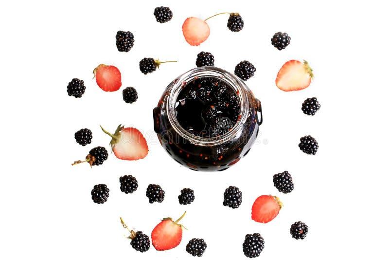 Blackberry y mermelada de fresa fotos de archivo