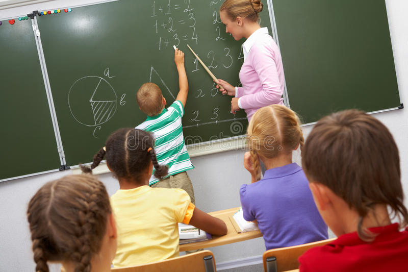 By the blackboard royalty free stock photography