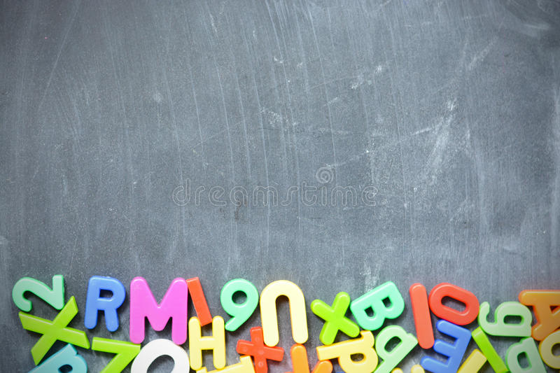 Blackboard background with colored letter blocks as frame royalty free stock image
