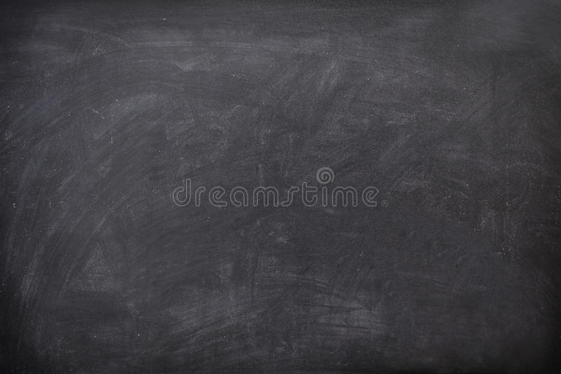 Blackboard / Chalkboard texture. Empty blank black chalkboard with chalk traces
