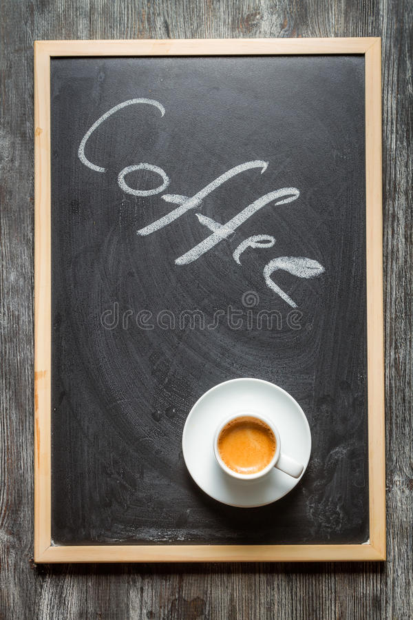 Blackboard with coffee and espresso royalty free stock photos