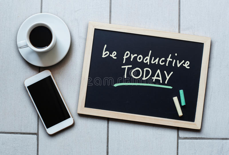 Blackboard concept saying Be Productive Today stock image
