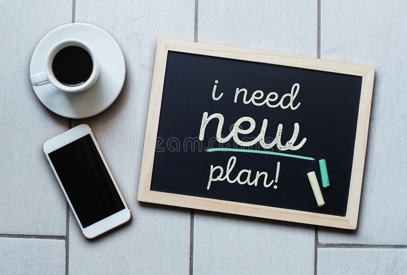 Blackboard concept saying I NEED NEW PLAN! stock image