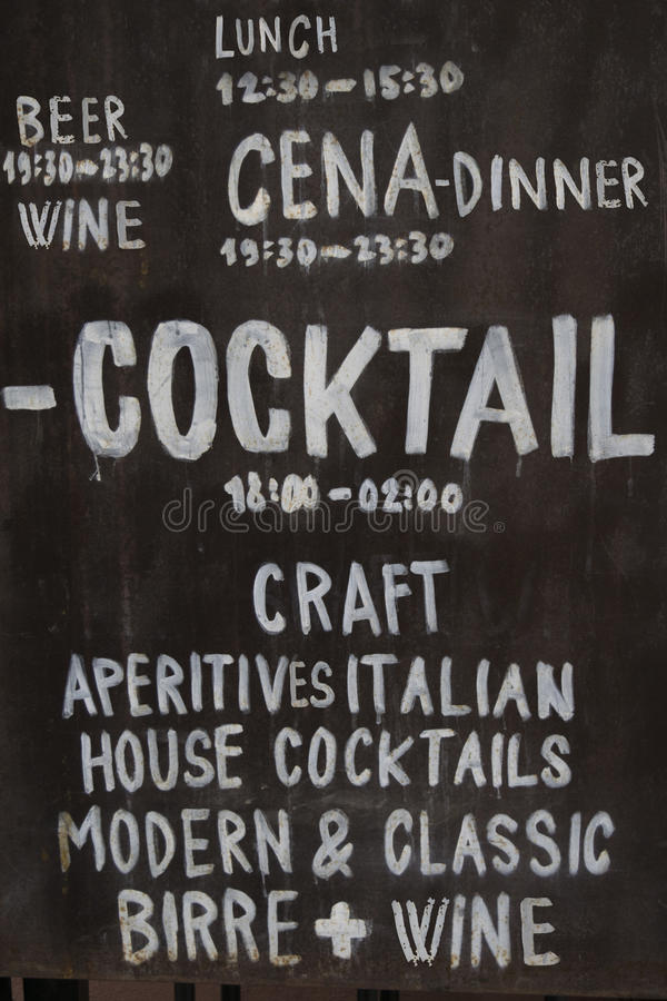 Blackboard with handmade writing indicating an Italian wine bar. Old blackboard used as sign of an Italian wine bar royalty free stock images