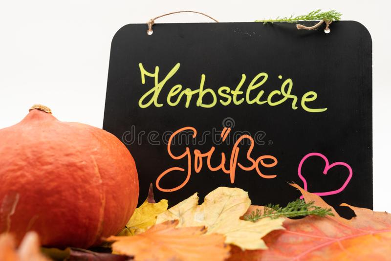 A blackboard with the inscription autumn greetings in german language. From the top stock image