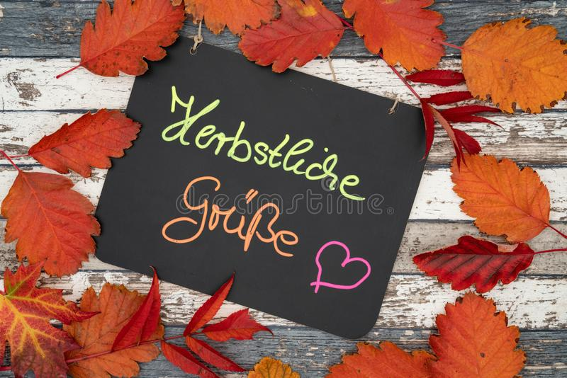 A blackboard with the inscription autumn greetings in german. From the top royalty free stock photos