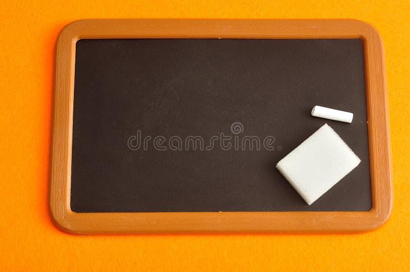 Blackboard, kreda i gumka, fotografia royalty free