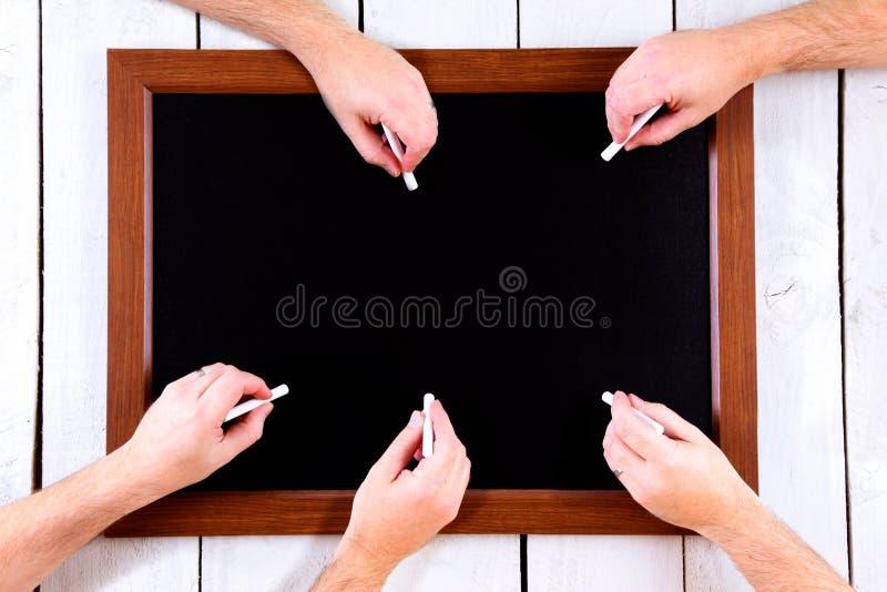blackboard kreda wręcza dużo zdjęcie royalty free