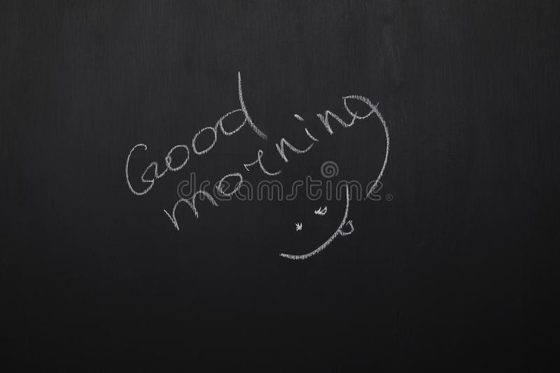Blackboard with lettering good morning and smile. royalty free stock photos