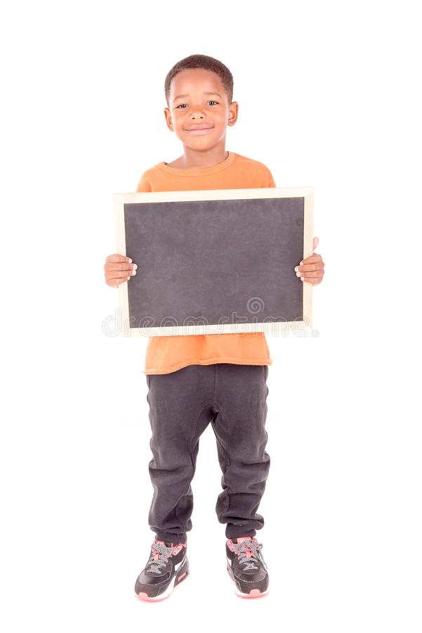Blackboard. Little boy holding a blackboard isolated in white royalty free stock photos