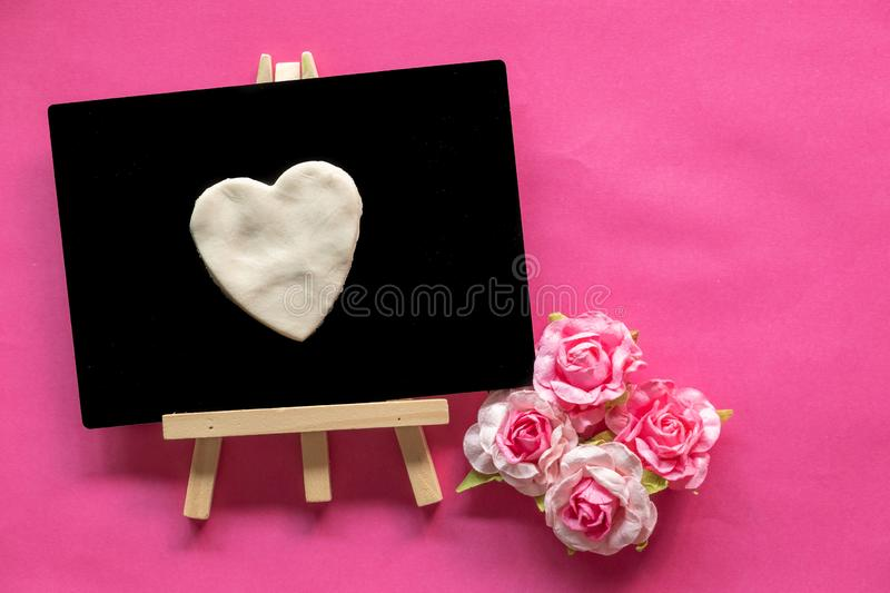 Blackboard with Love Heart on pink background and copy space, Love icon, Happy Valentines Day. Relationships concept stock images