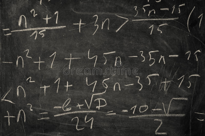 Blackboard with mathematical equations stock photography