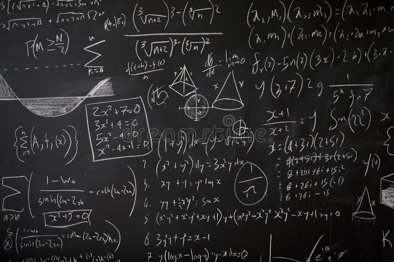 Blackboard with maths statistics, equations and ideas royalty free stock photo