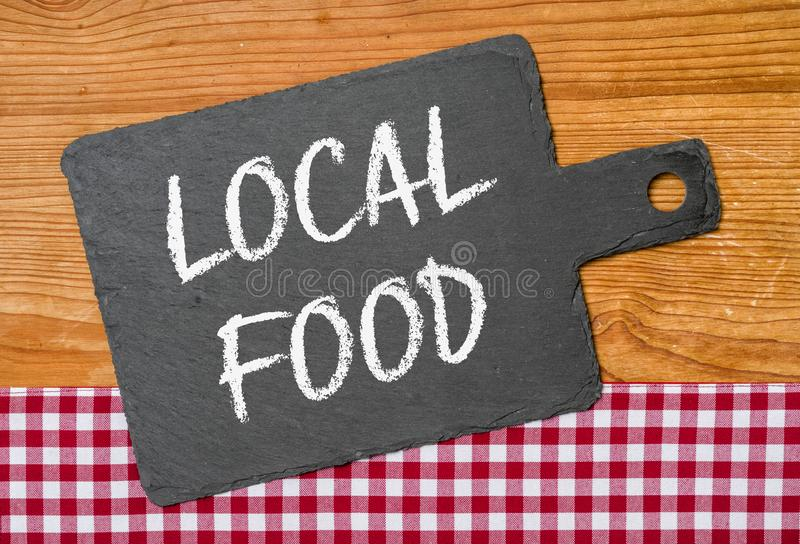 Local Food. A blackboard with a red checkered tablecloth - Local Food royalty free stock photography
