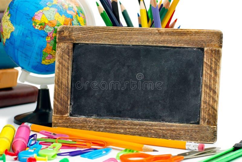 Blackboard with a school supplies stock photo
