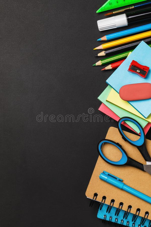 Blackboard with school supplies on the right side and copy space royalty free stock image