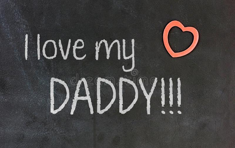 Blackboard with small red heart - I love my daddy stock photography