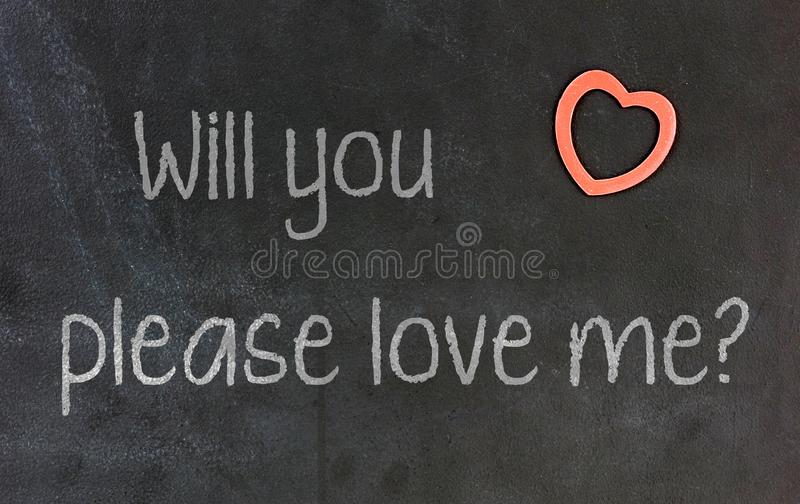 Blackboard with small red heart - Will you please love me royalty free stock images