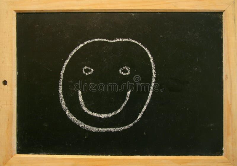 Blackboard smiley royalty free stock image