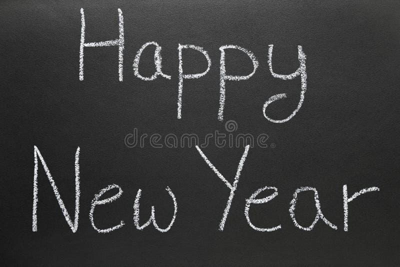 blackboard szczęśliwa nowa szkoła pisać rok obraz stock