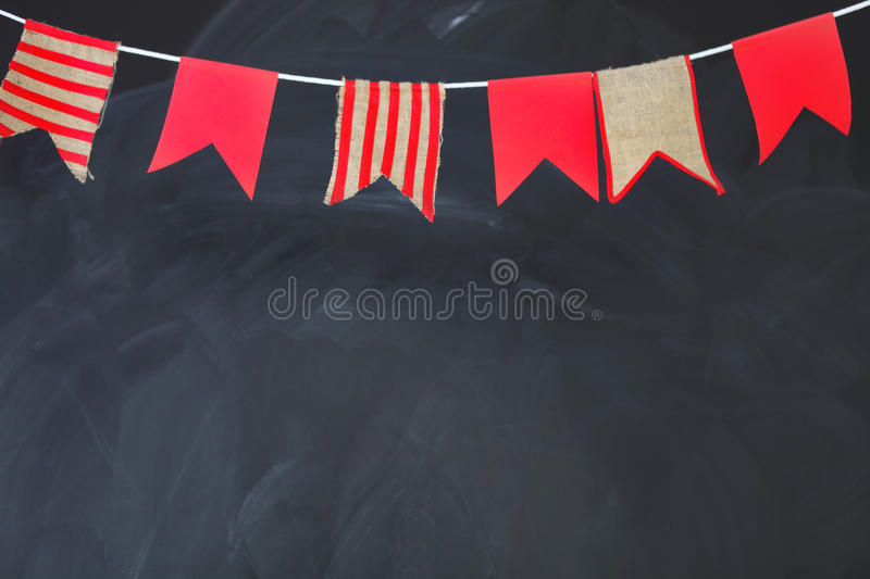 Blackboard texture background. Empty blank black chalkboard with. Chalk traces decorated by flags royalty free stock images
