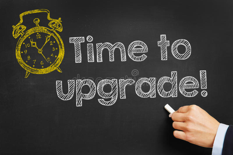 Blackboard with Time to upgrade. Hand writes Time to upgrade on blackboard stock images