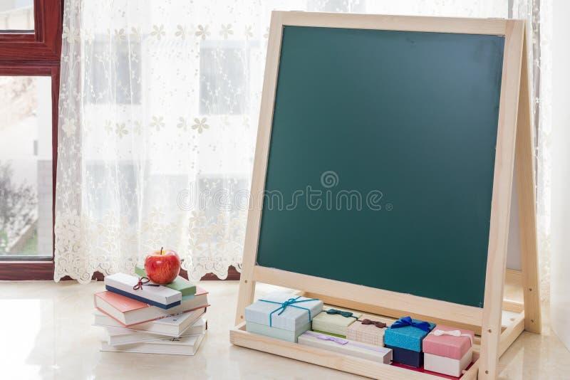 The blackboard on the windowsill. The blank blackboard on the windowsill royalty free stock photography