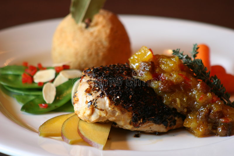 Blackened Chicken. With a sweet mango chutney stock image