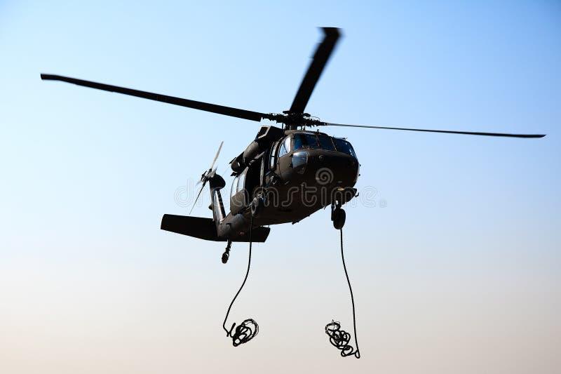 Blackhawk Dropping Ropes stock image
