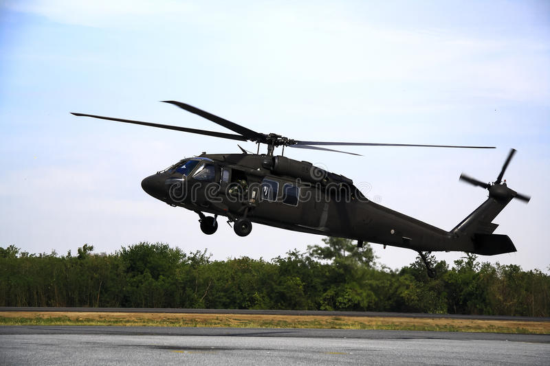 Blackhawk hovering. Helicopter uh-60 hovering on taxi way royalty free stock image