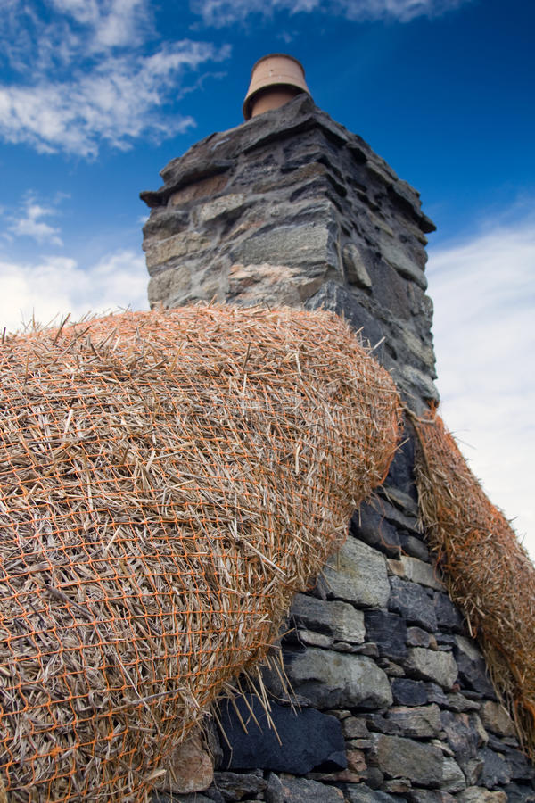 Blackhouse Chimney, Isle of Lewis, Scotland. Chimney and Thatch of an old Blackhouse Croft on the Isle of Lewis, Western Isles of Scotland royalty free stock photos
