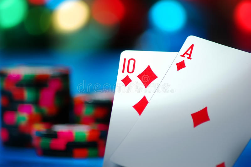 Blackjack!. An Ace and a Ten card make Blackjack on a blue background royalty free stock images